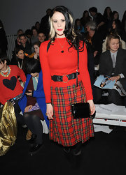 Kate Nash showed her funky style with a long red plaid skirt at the Ashish runway show in London.