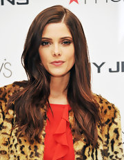 Ashley Greene visited Macy's Herald Square wearing her long subtly waved tresses parted to the side.