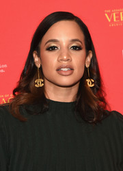 Dascha Polanco jazzed up her lobes with a pair of dangling Chanel earrings.