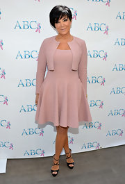 Kris Jenner paired her adorable mauve dress and jacket with strappy black leather platform sandals.