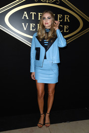 Chiara Ferragni suited up in edgy style with this blue Versace leather jacket and skirt combo for the Atelier Versace fashion show.