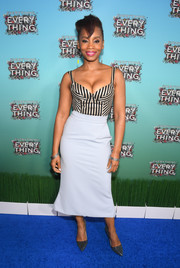 Anika Noni Rose showed off her assets in a striped corset top while attending the Atlanta junket for 'Everything, Everything.'