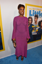 Issa Rae paired her dress with black broad-strap sandals.