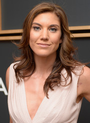 Hope Solo attended the White House Correspondents' Association pre-dinner looking glam with her feathered flip.