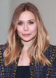 Elizabeth Olsen attended a performance of 'Bring It on Home' wearing her hair long and casual.