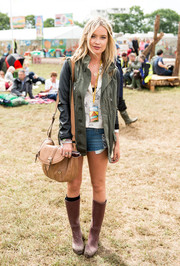 To combat unexpected mud, Laura Whitmore opted for rain boots during day 1 of England's Glastonbury Festival.
