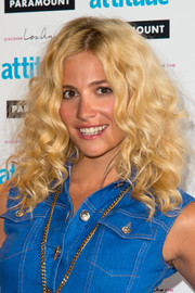 Pixie Lott was fabulously coiffed with voluminous curls during the Attitude Magazine Hot 100 party.