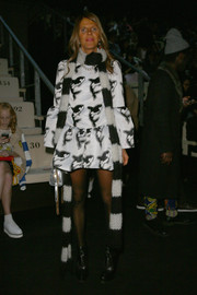 Anna dello Russo went for a fun and flirty look in a black-and-white orca-print dress by Au Jour Le Jour during the label's fashion show.
