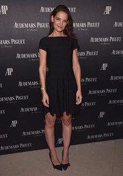 Katie Holmes kept it low-key in a little black dress at the Reconstruction of the Universe event.