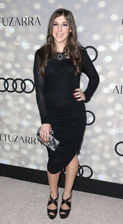 Mayim Bialik teamed black cross-strap peep-toes with a long-sleeve LBD for a sophisticated finish at the Emmy kickoff party.