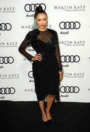 Kat Graham topped off her beaded black frock with classic stilettos.