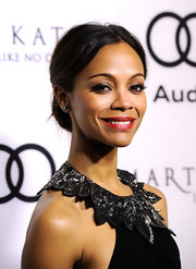 Zoe Saldana wore her hair in a classic bun while celebrating the Golden Globe Awards.