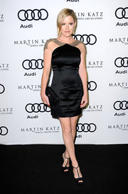 Kathleen Robertson opted for a chic black dress paired with black leather T-strap platform pumps.