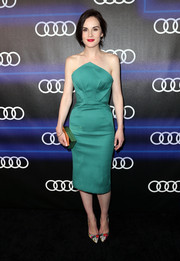 Michelle Dockery styled her frock with colorful floral pumps by Paul Andrew.