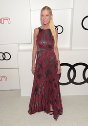 Tara Reid was edgy-glam in a red and black print gown during Audi's celebration of Emmys week.