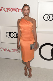 Kat Graham matched her shoes with a metallic silver clutch by Rebecca Minkoff.