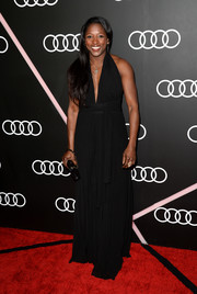 Rutina Wesley stepped out on the red carpet looking sexy in a black halter gown during the Golden Globes Weekend celebration.