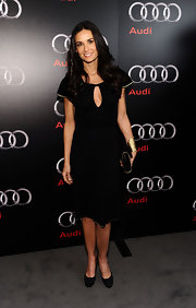 You can't go wrong with an LBD! Demi Moore looked stunning at the Audi Super Bowl party in a black key-hole cocktail dress and gold accessories.