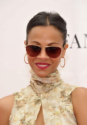 Zoe Saldana protected her peepers from the sun at the Foundation Polo Challenge in gold aviator sunglasses.