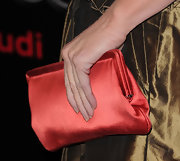 Kathy Griffin added a burst of color to her lovely look with a red satin clutch.