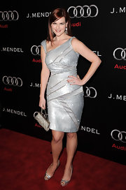 Sara was a silver queen in a shimmering cocktail dress and metallic shoes.