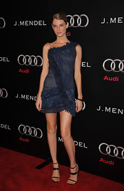 Angela Lindvall looked fantastic in minimalist black strappy sandals.