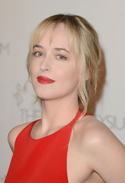 Dakota Johnson complemented her bright gown with an equally alluring red lip.