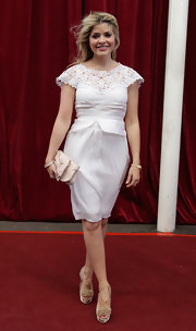 Holly Willoughby showed off her darling satin cluth while hitting the red carpet in London, England.