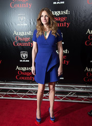 Julia Roberts stepped out on the 'August: Osage County' red carpet wearing a cobalt Proenza Schouler dress with a faux-wrap bodice and folded detail.