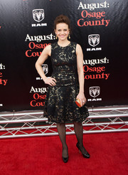 Carla Gugino oozed classic elegance in a black and gold lace cocktail dress by Carolina Herrera at the 'August: Osage County' NYC premiere.