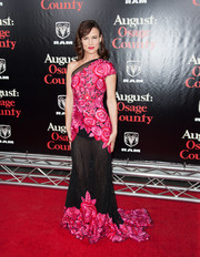 Juliette Lewis looked festively feminine in a fuchsia and black one-shoulder gown by Naeem Khan at the 'August: Osage County' NYC premiere.