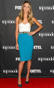 For her footwear, Jennifer Hawkins chose stylish teal suede pumps.