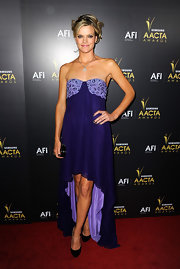 Missi topped off her purple frock with classic black pumps.