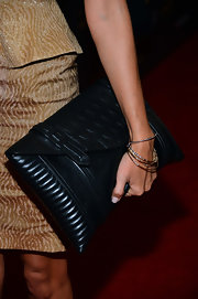Maria grabbed an oversized clutch for a red carpet appearance.