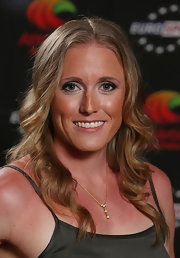 A dainty gold necklace with a studded pendant adorned Sally Pearson's neck while she kept the rest of her accessories low-key at the Australian Athlete of the Year Awards.