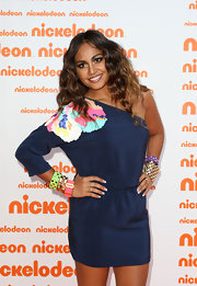 Jessica Mauboy paired her one-shoulder dress with an arm full of bangle bracelets.