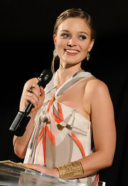 Bella Heathcote styled her resort look with a paved gold cuff at the 2010 Breakthrough Awards.