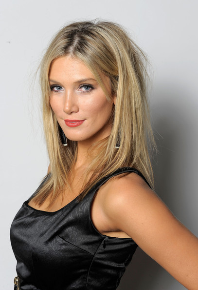 Delta Goodrem wore her hair in a mussed-up center-parted style at the 2010 Breakthrough Awards.