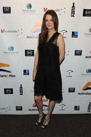 Jacinda Barrett teamed her black knee length dress with black satin T-strap heels.