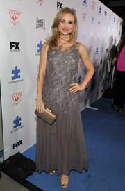 Fiona Gubelmann attended the Autism Speaks' Blue Jean Ball wearing an embellished gray evening dress.