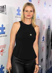 Joelle Carter paired a sleeveless black peplum top with leather pants for an edgy-chic finish at the Autism Speaks' Blue Jean Ball.