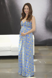 Autumn Reeser delicately showed off her baby bump with this blue and yellow printed jumpsuit.