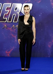 Scarlett Johansson went ultra modern in an asymmetrical black tuxedo jumpsuit by Tom Ford at the 'Avengers Endgame' UK fan event.