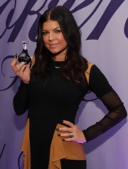 Fergie flaunted her signature talon nails while promoting her newest fragrance. She topped her look off with black nail polish.