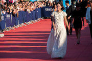Astrid Berges Frisbey went for old-school elegance in a short-sleeve white wool and lace gown by Chanel at the Deauville Film Fest premiere of 'Snowpierce.'