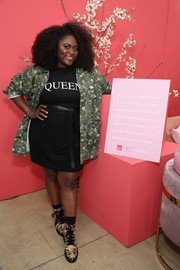 Danielle Brooks layered a camo jacket over a T-shirt dress for the Ax the Pink Tax panel.