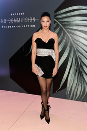 Adriana Lima paired her dress with cute black ankle-tie pumps.