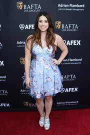 Jillian Rose Reed attended the BAFTA LA garden party looking sweet in a blue floral frock.