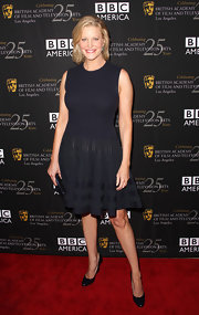 This textured black cocktail dress was perfectly flattering and sophisticated on Anna Gunn.
