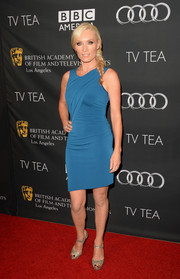 Victoria Smurfit glammed up her simple dress with a pair of glittery silver platform peep-toes.